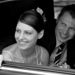 Newly married couple in wedding car