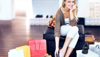 happy-woman-with-shoes-sale