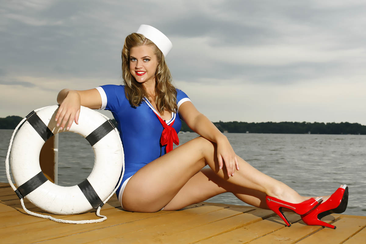 Sailor girl on Dock with Life Ring