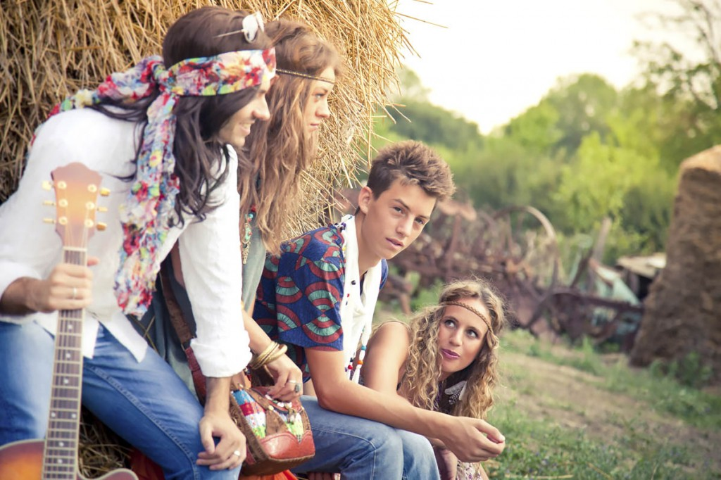 Hippie group with guitar having fun