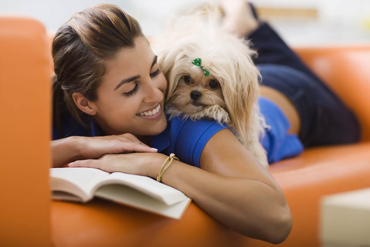 Woman relaxing with a dog