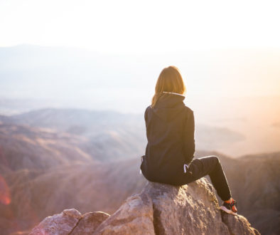 girl-at-top-of-mountain